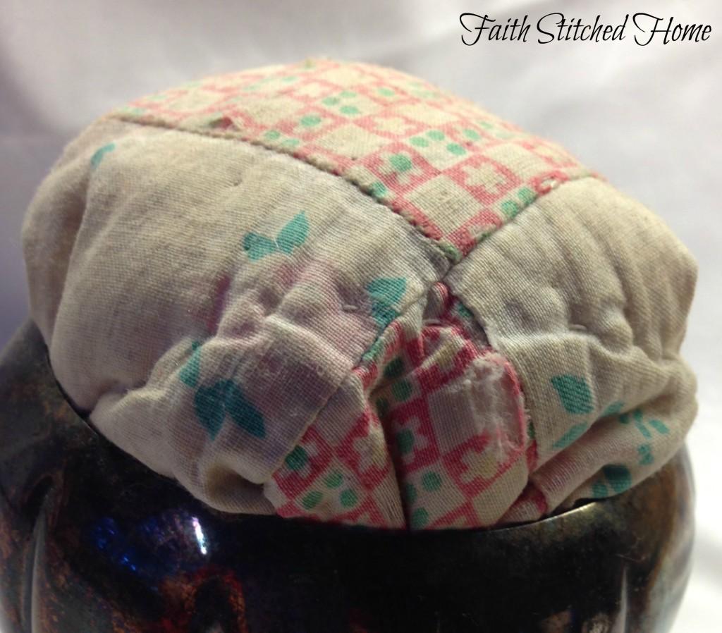 Vintage quilt pincushion closeup