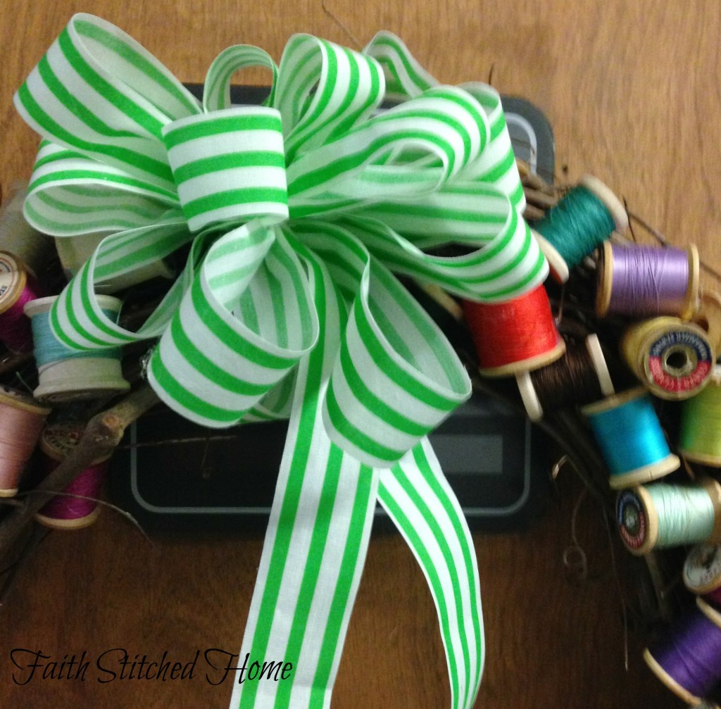 Vintage spool wreath with green bow