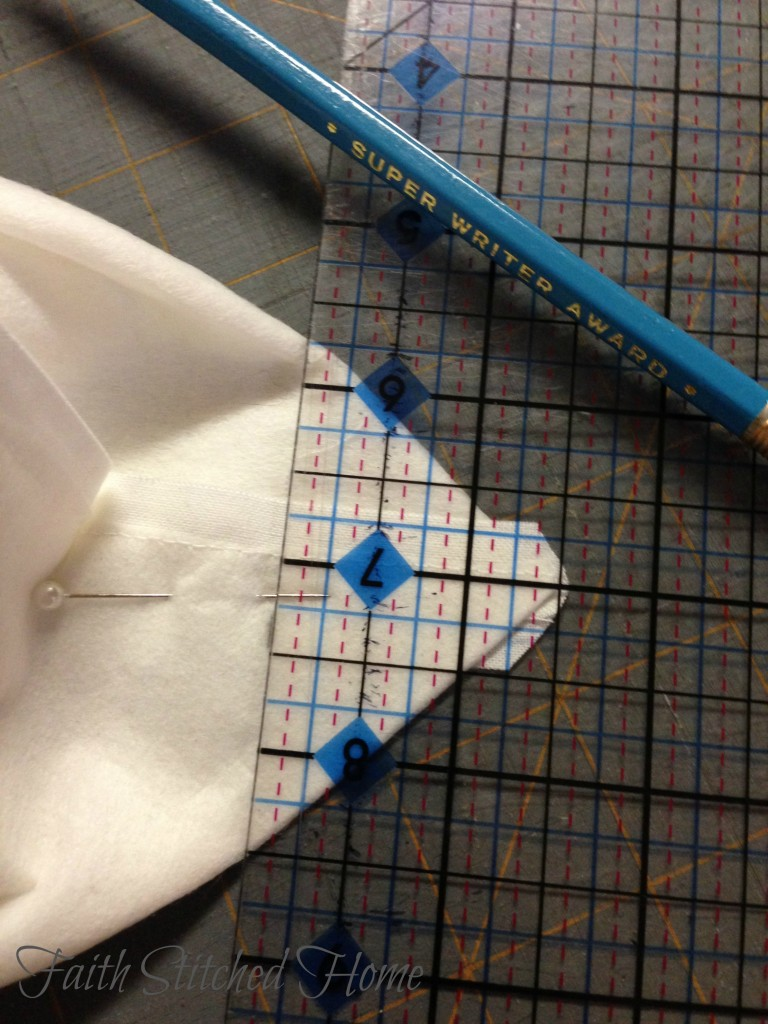 Not sure if you can tell, but I have the seam stitching lined up with the line on the ruler. This helps with being sure the marking is straight.