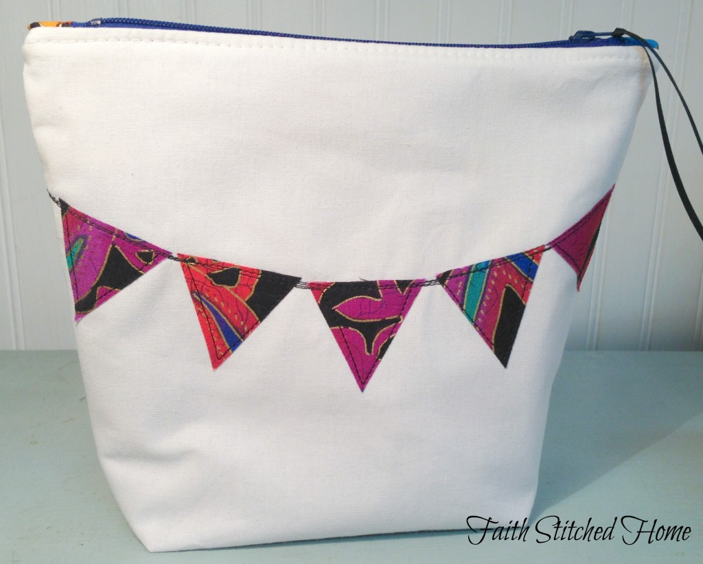 Zipper bag with pennant flag applique close-up