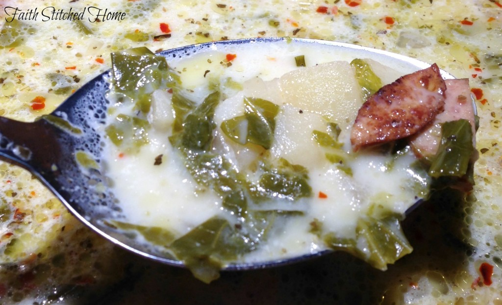Sausage and collard soup spoon
